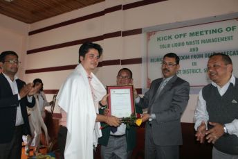 Lomas Dhungel receiving a commendation.